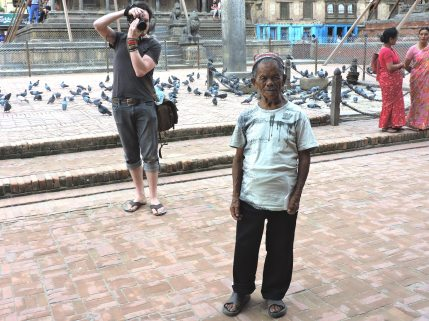 10% of the tourists that didn't cancel their trip to Nepal, an American photographer at work.