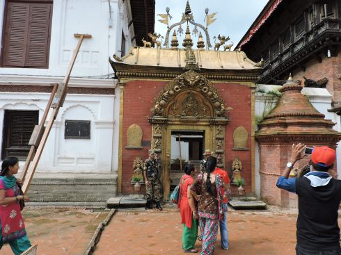Nepalese tourists taking pictures of their cultural heritage