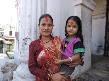 At Pashupatinath, on of the most sacred Hindu sites, mother and daughter posing for daddy with his cell phone (and for me)