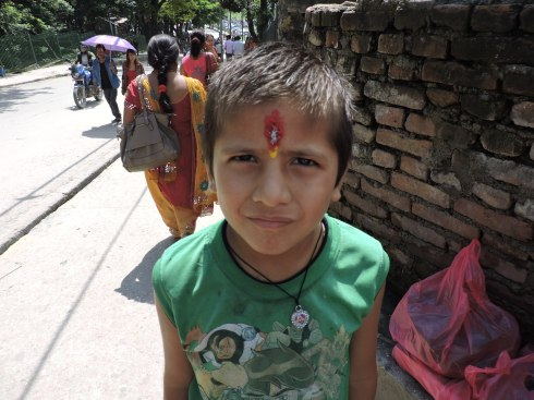 boy with tikka on his forehead, the centre of wisdom; no religious function without a tikka!