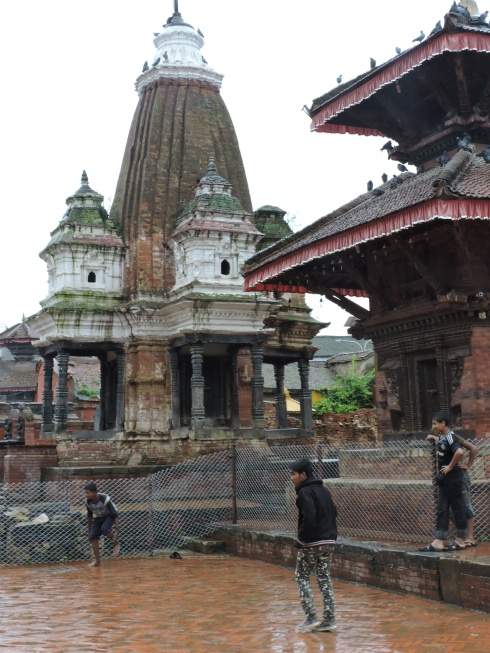 Playing soccer between the temples of Durbar Square, Patan
