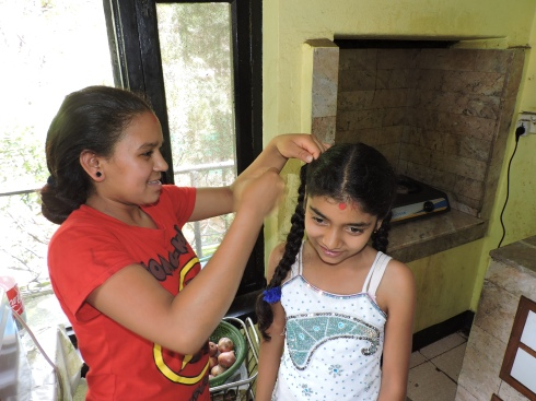 Januka helping Muskan do her hair