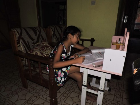 Muskan: studying in the dark during a blackout